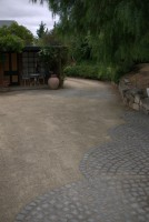 stone set in a curving pattern in gravel makes a beautiful pathway